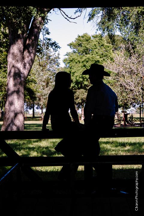 C. Baron Photography, rustic,Houston Wedding Photographer, Magnolia Wedding Photographer, old barn, cowboy boots, cowboy hat, cowboy culture, belt buckle, rodeo, engagement