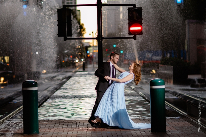 C. Baron Photography, Houston Engagement Photographer, downtown, dramatic, fountains, buildings, Blue Oscar Gown, fall, Formal Wear