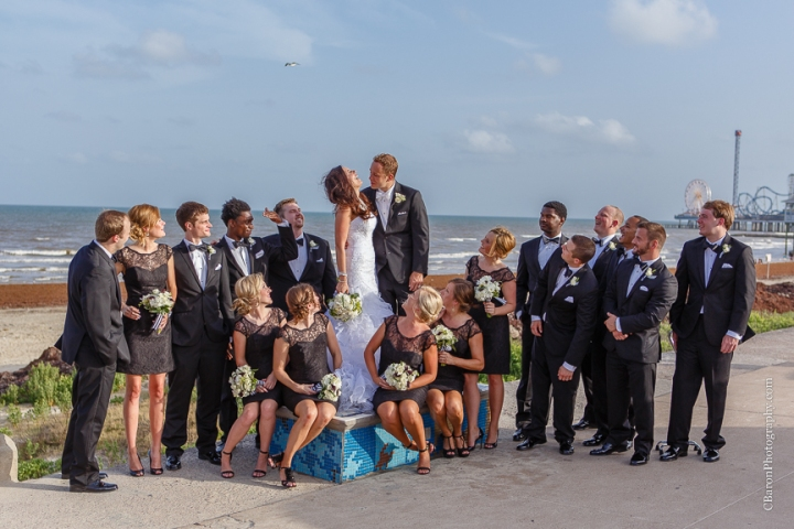 C. Baron Photography, Galveston Wedding Photographer, Hotel Galvez and Spa, beach, black, white, bride, groom, couple, Centennial Lawn, Music Hall, Downtown Blooms, Pleasure Pier, seawall, birds, sparklers, fit and flair gown, ruffles, June