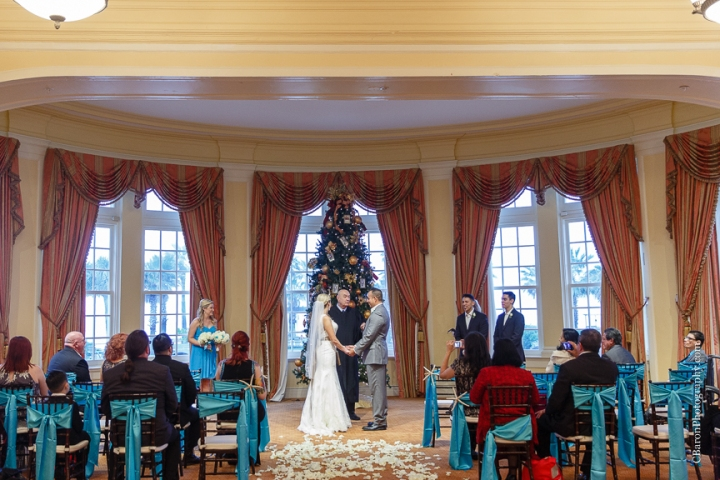 C. Baron Photography, Galveston Wedding Photographer, Hotel Galvez and Spa, blue, Christmas, December, Downtown Blooms, groom, bride, couple, seawall, waves, starfish, veil, umbrella, Pleasure Pier, rain, candy bar, beach
