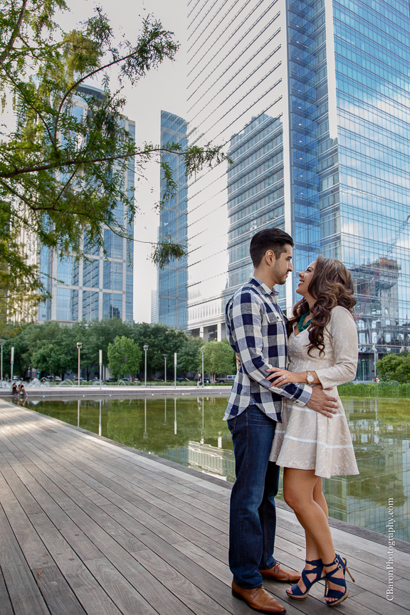 Buildings; C. Baron Photography; Couple; Discovery Green; Downtown; Dress; Engagement; Houston Engagement Photographer; Houston Wedding PHotographer; Nature; Park; Spring; Springtime; Texas;