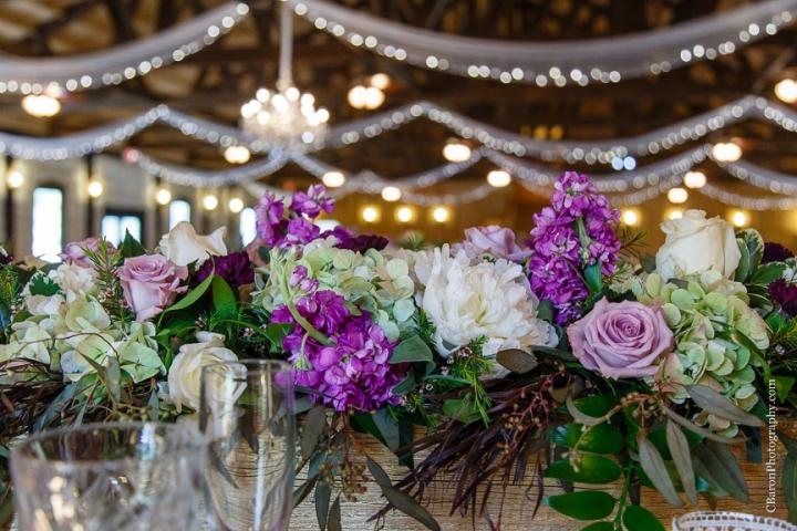 Bride; Couple; Cystal Springs; Groom; Houston Wedding Photographer; Magnolia; Purple; Springs Events; Texas; Wedding; Woodlands Wedding PHotographer; candles; crystal chandeliers; elegant; lavendar; lilac; outdoor ceremony;