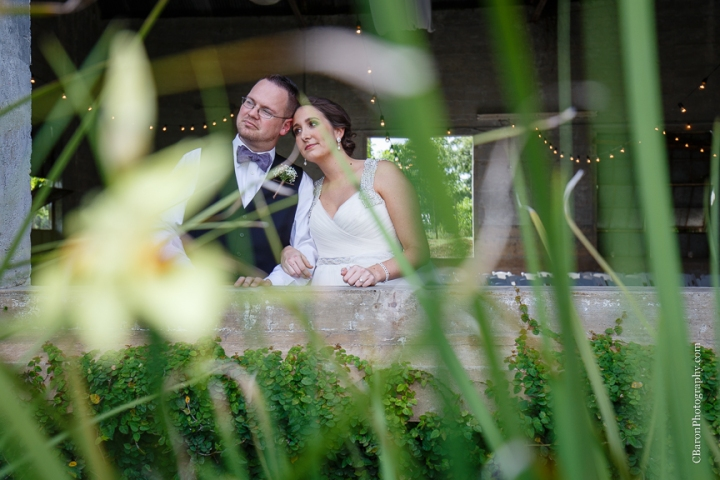Houston Wedding Photographer; Olde Dobbin Station. Texas Wedding PHotographer; Texas; Woodlands Wedding Photographer; c. Baron Photography; first look; handerchief hem; lavendar; navy; outdoor ceremony; purple; shoe game; sparklers; wedding; white;