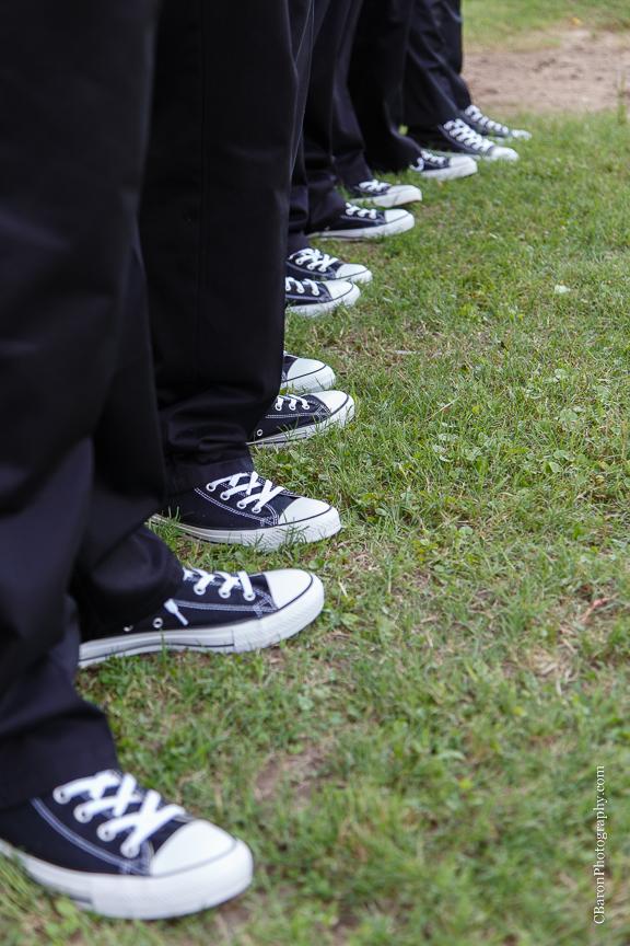 Houston Wedding Photographer; Olde Dobbin Station. Texas Wedding PHotographer; Texas; Woodlands Wedding Photographer; c. Baron Photography; first look; handerchief hem; lavendar; navy; outdoor ceremony; purple; shoe game; sparklers; wedding; white;