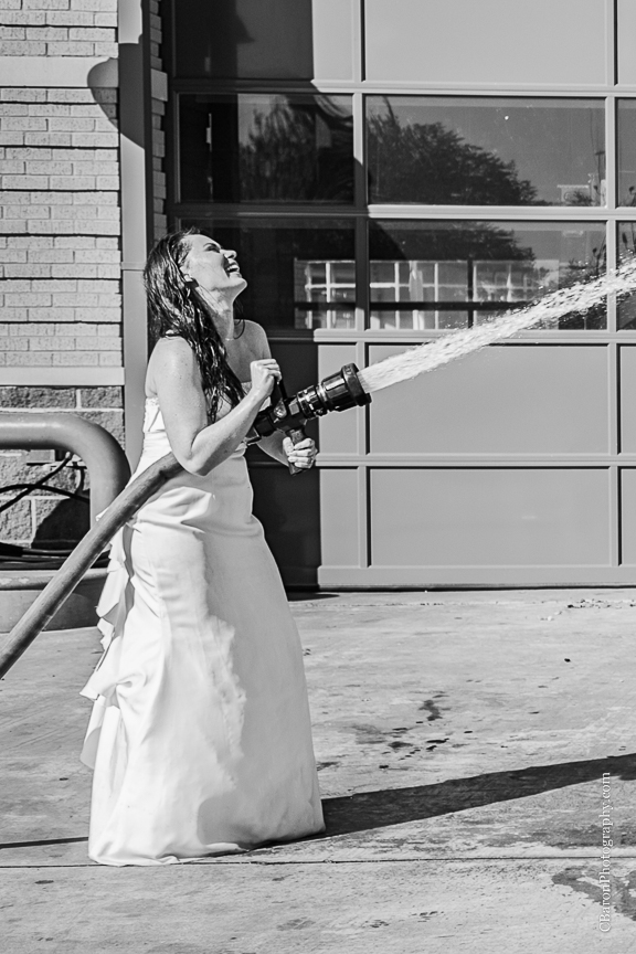 2013; Bride; C. Baron Photography; Downtown; Fire truck; HFD; Houston Wedding Photographer; Texas; fire hose; firemen; houston fire department; strapless gown; trash the dress;
