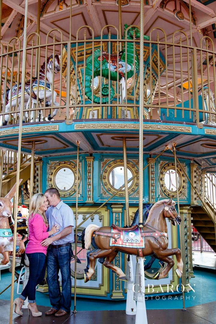 Beach; C. Baron Photography; Carnival; Couple; Engagement session; Galveston; Galveston Engagement Photographer; Galveston Island; Galveston Wedding Photographer; Houston Wedding Photographer; Pleasure Pier; Rides; Seawall; Texas; Texas Wedding Photographer; boardwalk; carousel; roller coaster;