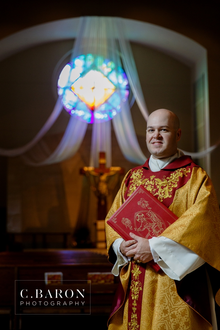 Houston; Ordination; Portrait photographer; Prince of Peace; Texas; altar; clergy; crucifix; portrait; priest; vestments;