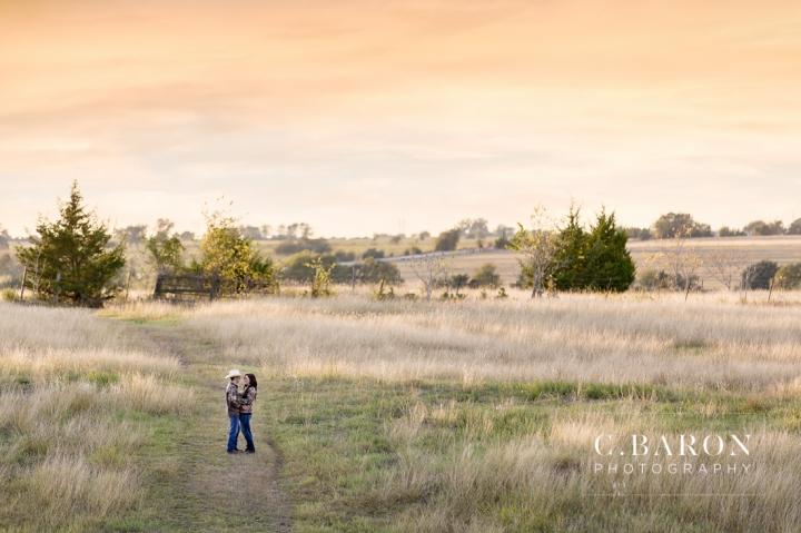 '32 Ford, Brenham Engagement Photographer, C. Baron Photography, camo, Country, Couple, cowboy hat, donkeys, Engagement session, farm, Fence, Grass, hills, Houston Engagement Photographer, John Deere Tractor, Old Oaks, sunset, Texas