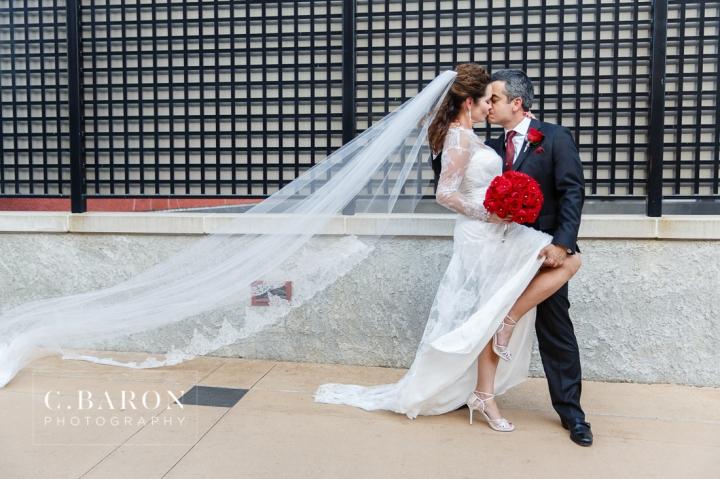 Al Capone Suite; Bride; C. Baron Photography; Couple; Dubuque; Groom; Hotel Julien; Houston Wedding Photographer; Iowa; Main Street; Red; Roses; Wedding; black; white;