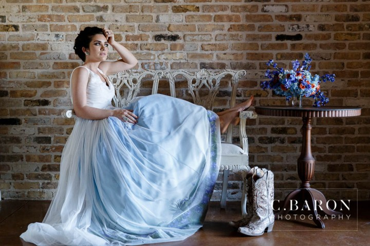 Bluebonnet season is here! These pretty little Texan shades of Blue are lining fields everywhere. We had the pleasure of creating a lovely Bluebonnet inspired shoot with some of our vendor friends at The Carriage House. We had gorgeous weather and it was so nice to get into the springtime weather! Just check out the bluebonnets on the bottom of that dress. Incredible, right? Photography: C. Baron Photography | Venue: The Carriage House Gown: Damsel White Label-Wimberly | Cake: Who made the Cake? Coordinator: Polished Wedding Planning | Makeup and Hair: Lisa Pelayo Makeup and Beauty