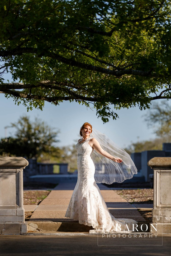 Aggies; Bluebonnets; Bridals; Campus; College Station wedding Photographer; Impression Bridal; TAMU; Texas A&M University; bottle cap Alley; on campus; red head. bridals; ruby engagement ring; sunny day; veil;