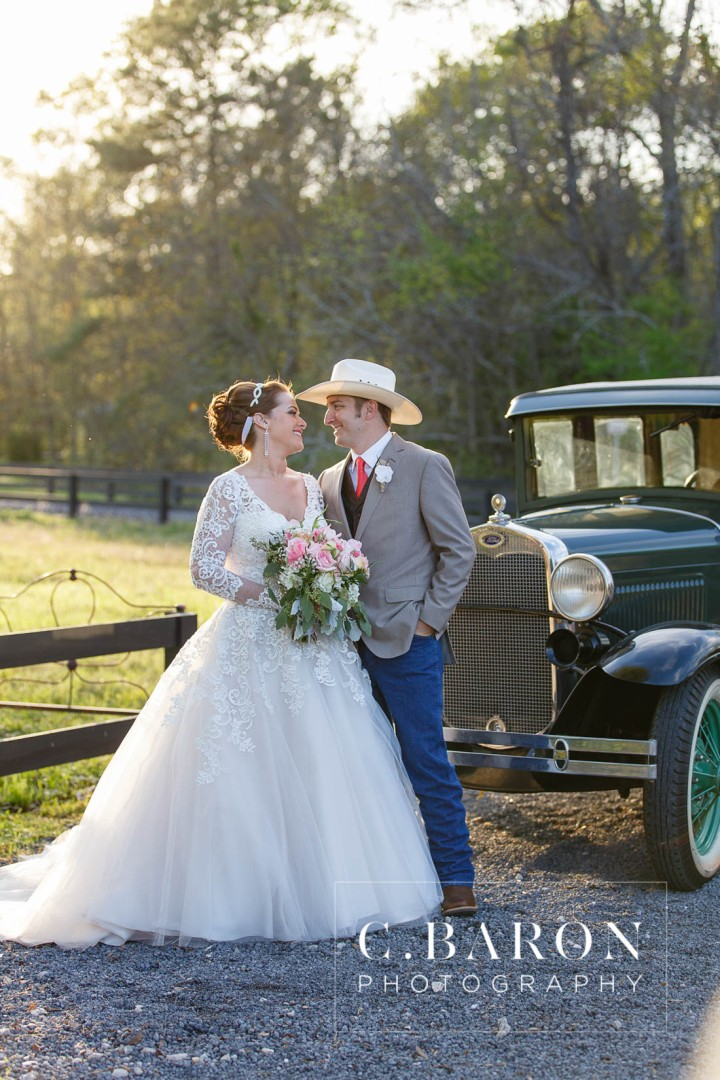 Austin Wedding Photographer; Barn; Beaumont wedding Photographer; C. Baron Photography; Church Pews; College Station wedding Photographer; Conroe; Conroe Wedding Photograher; Coral; Cowboy boots; Galveston Wedding Photographer; Houston wedding Photographer; Lake; Long Veil; Long-sleeved gown; Money Dance; Montgomery; Montgomery Wedding PHotographer; Old Ford; Outdoor Ceremony; Peach; Rustic; Shoe Game; Sparkler Exit; Spring; Texas; The Carriage House; Woodlands Wedding Photographer; arch; burlap; chandeliers; cowboy hat; lace; lace dress;