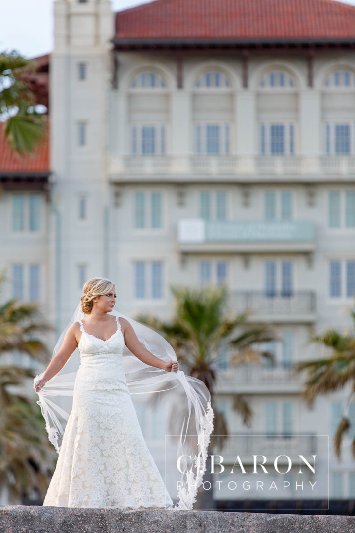 Beach; Bridals; C. Baron Photography; Formals; Galveston Island; Galveston Wedding Photographer; Historic Hotel; Hotel Galvez; Houston wedding Photographer; Lace gown; Palm Trees; Seaside; Seawall; Spring; Texas Wedding Photographer; sunny afternoon;
