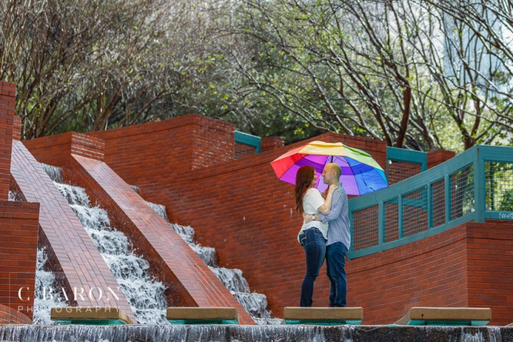 C. Baron Photography; Engagement session; Galveston Wedding Photographer; Houston Engagement Photographer; Houston wedding Photographer; Rainy Day; Sesquicentennial Park; buffalo bayou; downtown Houston; skyline; stormy; winter;