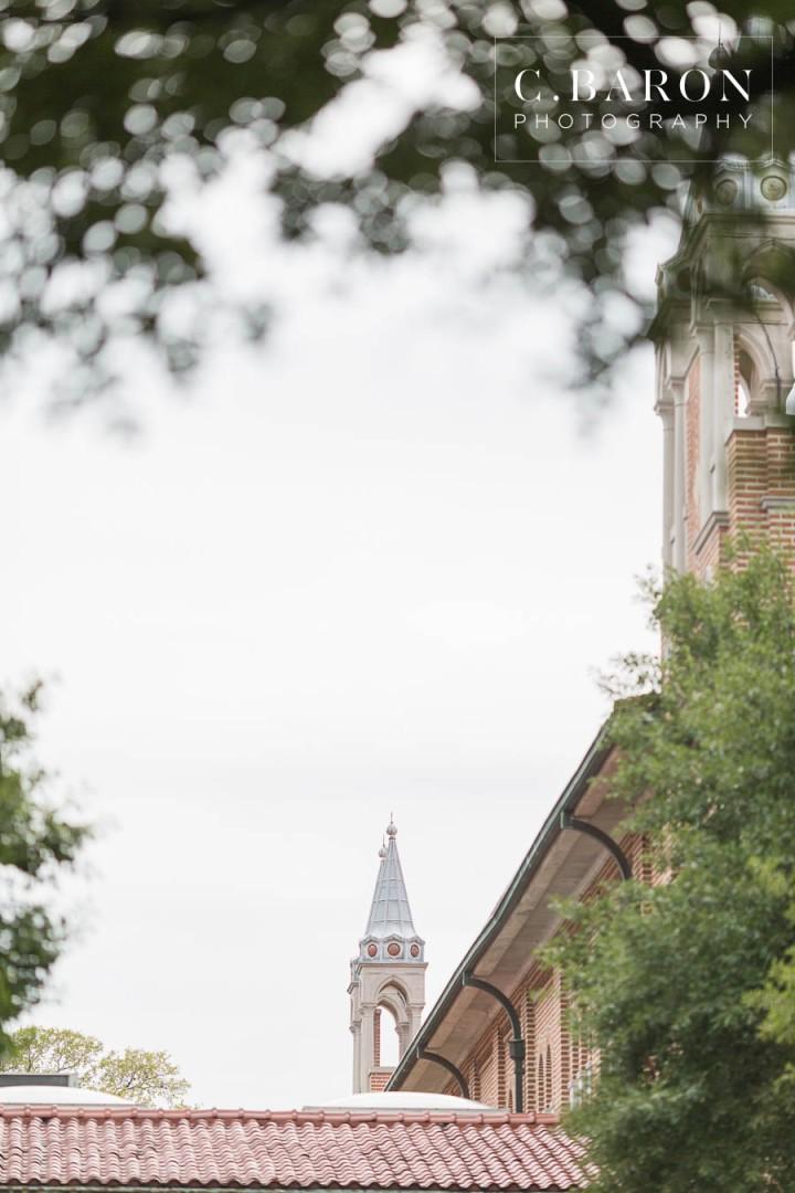 C. Baron Photography; Houston Engagement Photographer; Live Oaks; Rainy Day; Rice University; Texas Weddings; archway; blue shirt; heads together; summer;