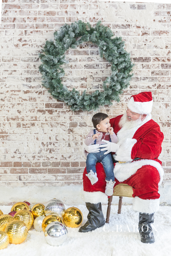 Cute Christmas Santa mini sessions at downtown Houston Texas stu